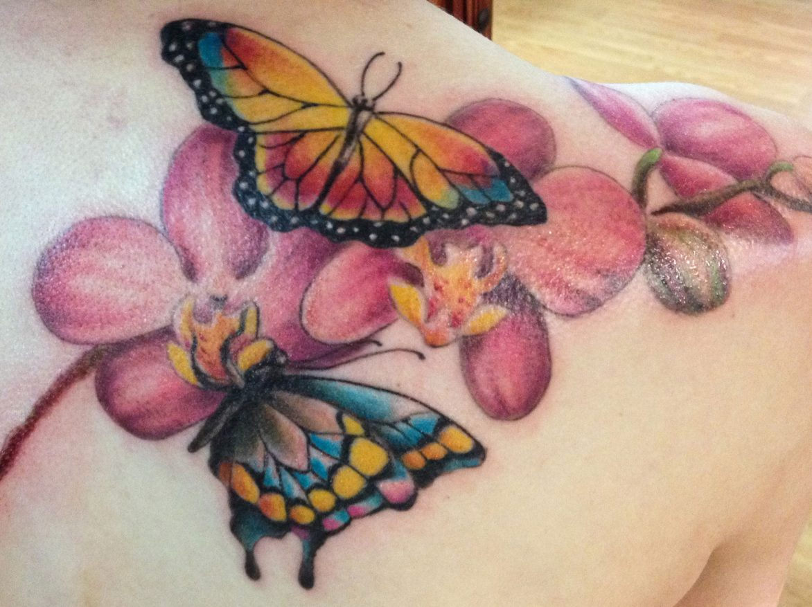 two butterflies and flower tat