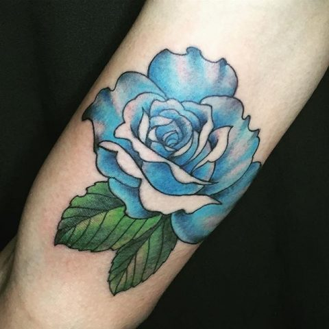 blue flower arm tattoo
