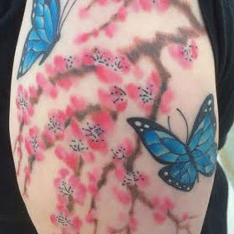 butterflies and cherry blossoms tattoo