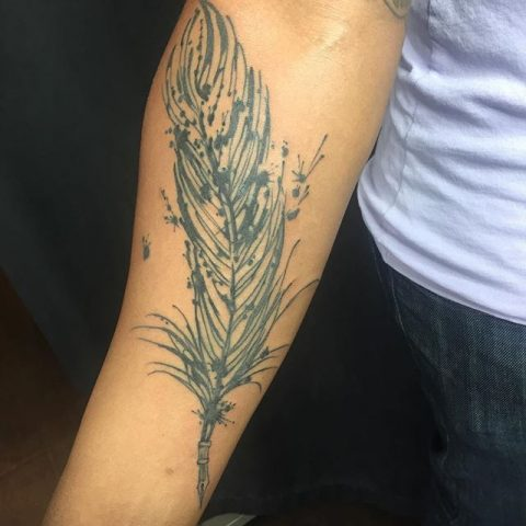 forearm feather tattoo