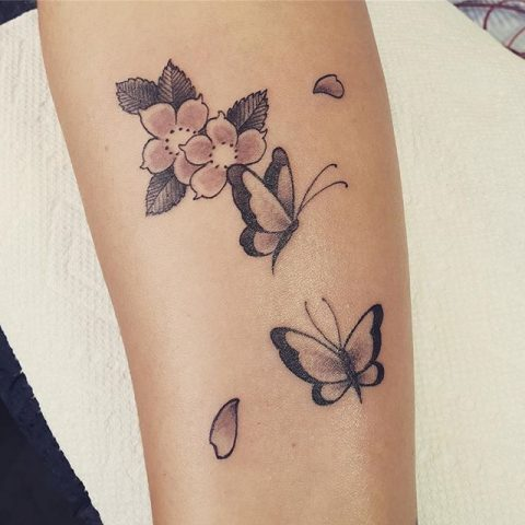 simple flowers and butterflies tattoo