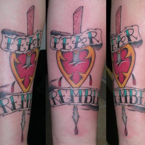 harpoon heart tattoo
