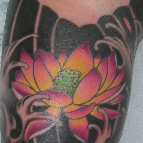 inner arm lotus tattoo