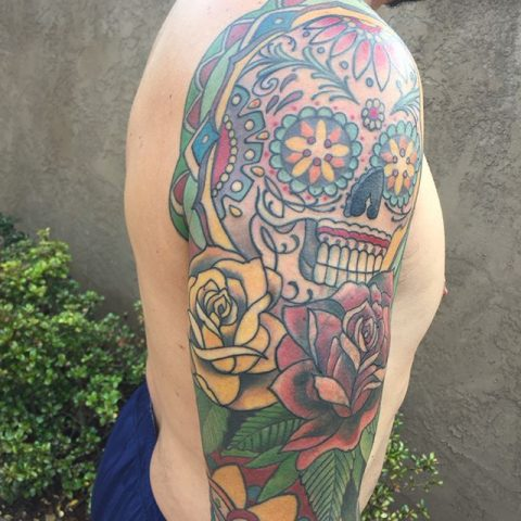 Mexican art arm tattoo