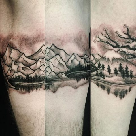 mountains on arm tattoo