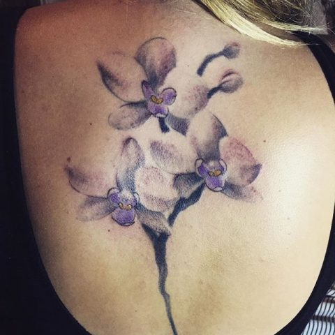 purple watercolor flowers tattoo