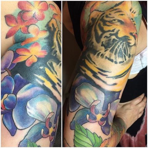 tiger and flowers sleeve tattoo