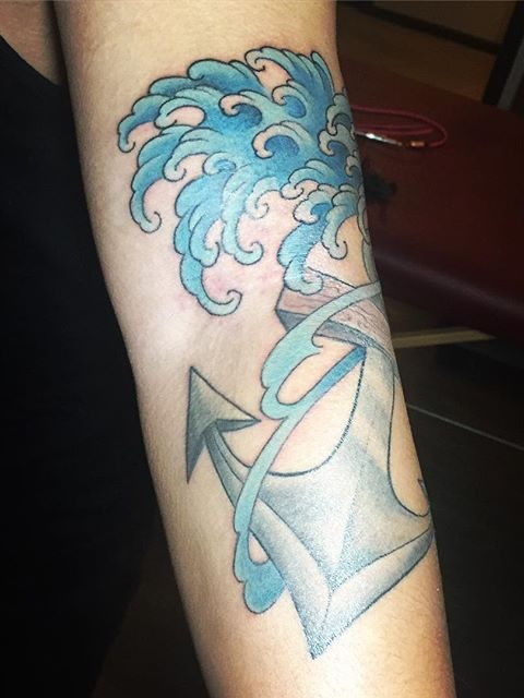 waves and anchor tattoo