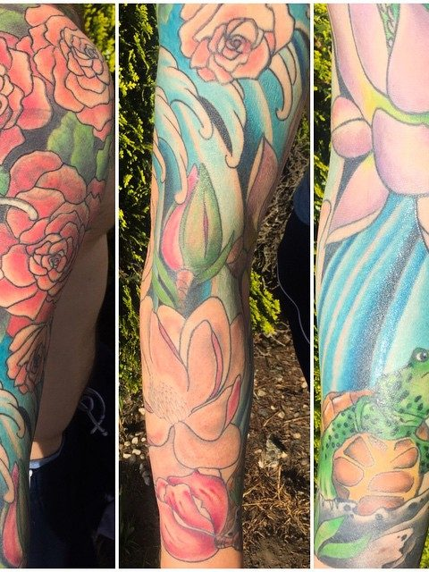 flowers waves turtle sleeve tattoo