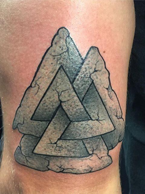 rock triangles tattoo