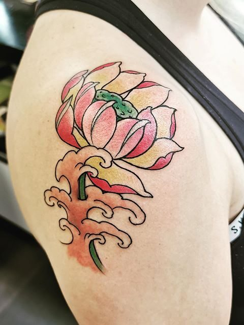 flower waves shoulder tattoo